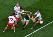 28 August 2021; Diarmuid O'Connor of Kerry in action against Tyrone players, from left, Mark Bradley, Ben McDonnell, Michael McKernan, and Darragh Canavan, during the GAA Football All-Ireland Senior Championship semi-final match between Kerry and Tyrone at Croke Park in Dublin. Photo by Daire Brennan/Sportsfile