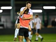 28 August 2021; Jackson Ryan of Maynooth Town celebrates with team-mate Sven Biansumba at the final whistle after the extra.ie FAI Cup Second Round match between Maynooth University Town and Cobh Ramblers at John Hyland Park in Baldonnell, Dublin. Photo by Eóin Noonan/Sportsfile