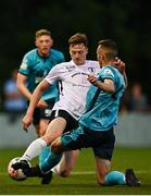 28 August 2021; Eoin O'Neill of Maynooth Town is tackled by Lee Devitt of Cobh Ramblers during the extra.ie FAI Cup Second Round match between Maynooth University Town and Cobh Ramblers at John Hyland Park in Baldonnell, Dublin. Photo by Eóin Noonan/Sportsfile