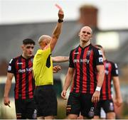 29 August 2021; Georgie Kelly of Bohemians reacts as he is shown a red card by referee Neil Doyle during the extra.ie FAI Cup second round match between Bohemians and Shamrock Rovers at Dalymount Park in Dublin. Photo by Eóin Noonan/Sportsfile