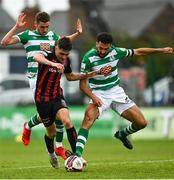 29 August 2021; Dawson Devoy of Bohemians in action against Dylan Watts, left, and Roberto Lopes of Shamrock Rovers during the extra.ie FAI Cup second round match between Bohemians and Shamrock Rovers at Dalymount Park in Dublin. Photo by Eóin Noonan/Sportsfile