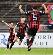 29 August 2021; Andy Lyons of Bohemians, centre, celebrates after scoring his side's second goal with team-mates Rob Cornwall, right, and Liam Burt during the extra.ie FAI Cup second round match between Bohemians and Shamrock Rovers at Dalymount Park in Dublin. Photo by Stephen McCarthy/Sportsfile
