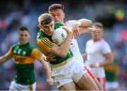 28 August 2021; Diarmuid O'Connor of Kerry is tackled by Michael McKernan of Tyrone during the GAA Football All-Ireland Senior Championship semi-final match between Kerry and Tyrone at Croke Park in Dublin. Photo by Stephen McCarthy/Sportsfile