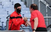 28 August 2021; Tyrone minor team manager Gerard Donnelly congratulated Tyrone joint-manager Feargal Logan following the GAA Football All-Ireland Senior Championship semi-final match between Kerry and Tyrone at Croke Park in Dublin. Photo by Stephen McCarthy/Sportsfile