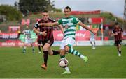 29 August 2021; Graham Burke of Shamrock Rovers in action against Andy Lyons of Bohemians during the extra.ie FAI Cup second round match between Bohemians and Shamrock Rovers at Dalymount Park in Dublin. Photo by Stephen McCarthy/Sportsfile