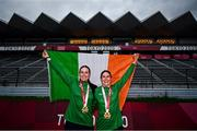 31 August 2021; Eve McCrystal, left, and Katie George Dunlevy of Ireland, celebrate with the Irish tri-colour and their gold medals during the medal ceremony after the Women's B Time Trial at the Fuji International Speedway on day seven during the Tokyo 2020 Paralympic Games in Shizuoka, Japan. Photo by David Fitzgerald/Sportsfile