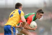 21 July 2013; Cian Hanley, Mayo, in action against Evan McGrath, Roscommon. Electric Ireland Connacht GAA Football Minor Championship Final, Roscommon v Mayo, Elverys MacHale Park, Castlebar, Co. Mayo. Picture credit: Stephen McCarthy / SPORTSFILE