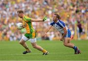 21 July 2013; Anthony Thompson, Donegal, in action against Padraig Donaghy, Monaghan. Ulster GAA Football Senior Championship Final, Donegal v Monaghan, St Tiernach's Park, Clones, Co. Monaghan. Picture credit: Oliver McVeigh / SPORTSFILE