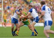 21 July 2013; Paddy McGrath, Donegal, in action against Padraig Donaghy and Owen Lennon, Monaghan. Ulster GAA Football Senior Championship Final, Donegal v Monaghan, St Tiernach's Park, Clones, Co. Monaghan. Picture credit: Oliver McVeigh / SPORTSFILE