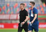 1 September 2021; Republic of Ireland manager Stephen Kenny and FAI communications executive Kieran Crowley before the FIFA World Cup 2022 qualifying group A match between Portugal and Republic of Ireland at Estádio Algarve in Faro, Portugal. Photo by Seb Daly/Sportsfile