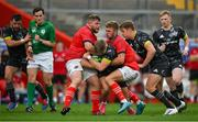 4 September 2021; Alan Flannery of Munster Grey XV is tackled by Liam O'Connor, left, and Jack Crowley of Munster Red VX during a challenge match between Munster XV Red and Munster XV Grey at Thomond Park in Limerick. Photo by Brendan Moran/Sportsfile