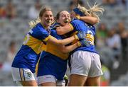 5 September 2021; Wicklow players, from left, Paula Faulkner, Megan Healy and Sarah Jane Winders celebrate at the final whistle of the TG4 All-Ireland Ladies Junior Football Championship Final match between Antrim and Wicklow at Croke Park in Dublin. Photo by Brendan Moran/Sportsfile