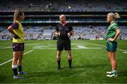 5 September 2021; Referee Shane Curley with Wexford captain Aisling Murphy and Westmeath captain Fiona Claffey before the TG4 All-Ireland Ladies Intermediate Football Championship Final match between Westmeath and Wexford at Croke Park in Dublin. Photo by Stephen McCarthy/Sportsfile
