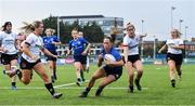 4 September 2021; Emily McKeown of Leinster gets away from Toni Macartney of Ulster, second from right, and Rachael McIlroy, left, on her way to scoring a try during the IRFU Women's Interprovincial Championship Round 2 match between Leinster and Ulster at Energia Park in Dublin. Photo by Piaras Ó Mídheach/Sportsfile
