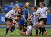 4 September 2021; Vic O'Mahony of Leinster is tackled by Taryn Schutzler, left, and Rachael McIlroy, centre, of Ulster during the IRFU Women's Interprovincial Championship Round 2 match between Leinster and Ulster at Energia Park in Dublin. Photo by Piaras Ó Mídheach/Sportsfile