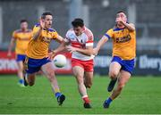 10 September 2021; Enda O'Sullivan of Whitehall Colmcille in action against Niall McGovern, left, and John Kelly of Na Fianna during the Go Ahead Dublin Senior Club Football Championship Group 1 match between Na Fianna and Whitehall Colmcille at Parnell Park in Dublin. Photo by Daire Brennan/Sportsfile