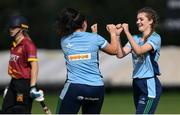 11 September 2021; Annabelle Burton of CSNI celebrates with team-mate Ash Healy, left, after taking the wicket of Stephanie Wilkinson of Bready during the Clear Currency Women's All-Ireland T20 Cup Semi-Final match between Bready and CSNI at Bready Cricket Club in Tyrone. Photo by Ben McShane/Sportsfile