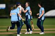 11 September 2021; Annabelle Burton of CSNI celebrates with team-mates after taking the wicket of Stephanie Wilkinson of Bready during the Clear Currency Women's All-Ireland T20 Cup Semi-Final match between Bready and CSNI at Bready Cricket Club in Tyrone. Photo by Ben McShane/Sportsfile