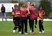 11 September 2021; Amy Campbell, centre, celebrates with her Bready team-mate after catching out Rachael Thomas of CSNI during the Clear Currency Women's All-Ireland T20 Cup Semi-Final match between Bready and CSNI at Bready Cricket Club in Tyrone. Photo by Ben McShane/Sportsfile