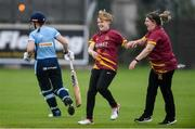 11 September 2021; Kaylee Barnard of Bready, centre, celebrates with team-mate Stephanie Wilkinson, right, after claiming the wicket of Sophie Thomas of CSNI during the Clear Currency Women's All-Ireland T20 Cup Semi-Final match between Bready and CSNI at Bready Cricket Club in Tyrone. Photo by Ben McShane/Sportsfile