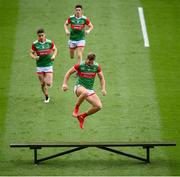 11 September 2021; Aidan O'Shea of Mayo jumps over a bench before the GAA Football All-Ireland Senior Championship Final match between Mayo and Tyrone at Croke Park in Dublin. Photo by Stephen McCarthy/Sportsfile