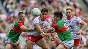 11 September 2021; Michael McKernan of Tyrone is tackled by Ryan O'Donoghue and Conor Loftus of Mayo during the GAA Football All-Ireland Senior Championship Final match between Mayo and Tyrone at Croke Park in Dublin. Photo by Brendan Moran/Sportsfile