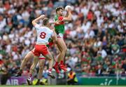 11 September 2021; Aidan O'Shea, right, and Diarmuid O'Connor of Mayo, hidden, in action against Brian Kennedy of Tyrone, 8, during the GAA Football All-Ireland Senior Championship Final match between Mayo and Tyrone at Croke Park in Dublin. Photo by Stephen McCarthy/Sportsfile