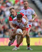 11 September 2021; Michael McKernan of Tyrone is tackled by Ryan O'Donoghue of Mayo during the GAA Football All-Ireland Senior Championship Final match between Mayo and Tyrone at Croke Park in Dublin. Photo by Brendan Moran/Sportsfile