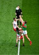 11 September 2021; Aidan O'Shea, right, and Diarmuid O'Connor of Mayo contest the throw-in against Brian Kennedy of Tyrone to start the GAA Football All-Ireland Senior Championship Final match between Mayo and Tyrone at Croke Park in Dublin. Photo by Daire Brennan/Sportsfile
