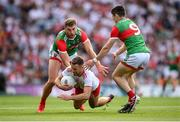 11 September 2021; Niall Sludden of Tyrone is tackled by Aidan O'Shea, left, and Conor Loftus of Mayo during the GAA Football All-Ireland Senior Championship Final match between Mayo and Tyrone at Croke Park in Dublin. Photo by Stephen McCarthy/Sportsfile