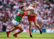 11 September 2021; Niall Sludden of Tyrone is tackled by Aidan O'Shea of Mayo during the GAA Football All-Ireland Senior Championship Final match between Mayo and Tyrone at Croke Park in Dublin. Photo by Stephen McCarthy/Sportsfile