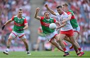 11 September 2021; Darren McCurry of Tyrone in action against Bryan Walsh, right, Pádraig O'Hora, centre, and Michael Plunkett of Mayo during the GAA Football All-Ireland Senior Championship Final match between Mayo and Tyrone at Croke Park in Dublin. Photo by Piaras Ó Mídheach/Sportsfile