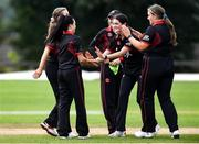 11 September 2021; Clíona Tucker, second from left, is congratulated by her Pembroke team-mates after taking the wicket of Jemma Rankin of Bready during the Clear Currency Women's All-Ireland T20 Cup Final match between Bready cricket club and Pembroke cricket club at Bready Cricket Club in Tyrone. Photo by Ben McShane/Sportsfile
