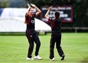11 September 2021; Louise Little of Pembroke celebrates with team-mate Clíona Tucker, right, after taking the wicket of Stephanie Wilkinson of Bready during the Clear Currency Women's All-Ireland T20 Cup Final match between Bready cricket club and Pembroke cricket club at Bready Cricket Club in Tyrone. Photo by Ben McShane/Sportsfile