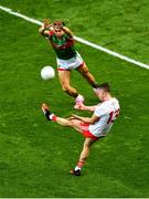 11 September 2021; Darren McCurry of Tyrone scores a point despite the challenge of Oisín Mullin of Mayo during the GAA Football All-Ireland Senior Championship Final match between Mayo and Tyrone at Croke Park in Dublin. Photo by Daire Brennan/Sportsfile