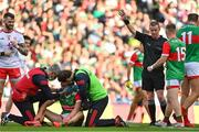 11 September 2021; Referee Joe McQuillan rewards a free to Mayo as Pádraig O'Hora of Mayo receives medical attention during the GAA Football All-Ireland Senior Championship Final match between Mayo and Tyrone at Croke Park in Dublin. Photo by Brendan Moran/Sportsfile