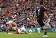 11 September 2021; Aidan O'Shea of Mayo has his shot charged down by Ronan McNamee of Tyrone during the GAA Football All-Ireland Senior Championship Final match between Mayo and Tyrone at Croke Park in Dublin. Photo by Ramsey Cardy/Sportsfile
