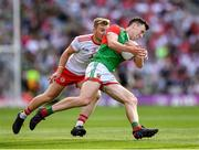 11 September 2021; Diarmuid O'Connor of Mayo in action against Michael O'Neill of Tyrone during the GAA Football All-Ireland Senior Championship Final match between Mayo and Tyrone at Croke Park in Dublin. Photo by Ray McManus/Sportsfile