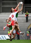 11 September 2021; Aidan O'Shea of Mayo wins the ball from the restart ahead of Conn Kilpatrick, hidden, and Brian Kennedy of Tyrone during the GAA Football All-Ireland Senior Championship Final match between Mayo and Tyrone at Croke Park in Dublin. Photo by David Fitzgerald/Sportsfile