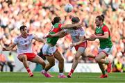11 September 2021; Matthew Donnelly of Tyrone is tackled by Oisín Mullin of Mayo during the GAA Football All-Ireland Senior Championship Final match between Mayo and Tyrone at Croke Park in Dublin. Photo by Brendan Moran/Sportsfile