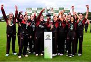 11 September 2021; Pembroke captain Mary Waldron lifts the cup with her team-mates after their victory in the Clear Currency Women's All-Ireland T20 Cup Final match between Bready cricket club and Pembroke cricket club at Bready Cricket Club in Tyrone. Photo by Ben McShane/Sportsfile