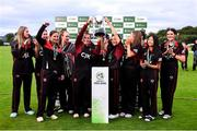 11 September 2021; Pembroke captain Mary Waldron lifts the cup with Clíona Tucker and her team-mates after their victory in the Clear Currency Women's All-Ireland T20 Cup Final match between Bready cricket club and Pembroke cricket club at Bready Cricket Club in Tyrone. Photo by Ben McShane/Sportsfile