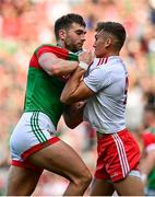 11 September 2021; Aidan O'Shea of Mayo tussels over the ball with Conn Kilpatrick of Tyrone during the GAA Football All-Ireland Senior Championship Final match between Mayo and Tyrone at Croke Park in Dublin. Photo by Seb Daly/Sportsfile