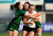 11 September 2021; Fiona Tuite of Ulster is tackled by Catherine Martin, left, and Ciara Farrell of Connacht during the Vodafone Women's Interprovincial Championship Round 3 match between Connacht and Ulster at Energia Park in Dublin. Photo by Harry Murphy/Sportsfile