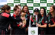 11 September 2021; Pembroke captain Mary Waldron with her team-mates after their victory in the Clear Currency Women's All-Ireland T20 Cup Final match between Bready cricket club and Pembroke cricket club at Bready Cricket Club in Tyrone. Photo by Ben McShane/Sportsfile