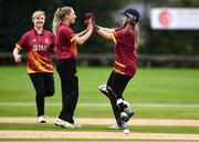 11 September 2021; Amy Campbell of Bready celebrates with team-mate Alana Dalzell, left, after taking the wicket of Louise Little of Pembroke during the Clear Currency Women's All-Ireland T20 Cup Final match between Bready cricket club and Pembroke cricket club at Bready Cricket Club in Tyrone. Photo by Ben McShane/Sportsfile