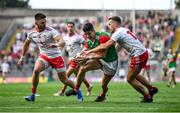 11 September 2021; Conor Loftus of Mayo is tackled by Niall Sludden, right, and Pádraig Hampsey of Tyrone during the GAA Football All-Ireland Senior Championship Final match between Mayo and Tyrone at Croke Park in Dublin. Photo by David Fitzgerald/Sportsfile