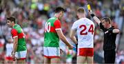 11 September 2021; Lee Keegan of Mayo, left, is shown a yellow card by referee Joe McQuillan during the GAA Football All-Ireland Senior Championship Final match between Mayo and Tyrone at Croke Park in Dublin. Photo by Brendan Moran/Sportsfile