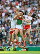 11 September 2021; Brian Kennedy, right, and Conn Kilpatrick of Tyrone in action against Aidan O'Shea, centre, and Diarmuid O'Connor of Mayo, hidden, during the GAA Football All-Ireland Senior Championship Final match between Mayo and Tyrone at Croke Park in Dublin. Photo by Stephen McCarthy/Sportsfile