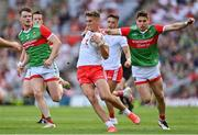 11 September 2021; Conn Kilpatrick of Tyrone is tackled by Lee Keegan of Mayo, for which he recieved a yellow card by referee Joe McQuillan during the GAA Football All-Ireland Senior Championship Final match between Mayo and Tyrone at Croke Park in Dublin. Photo by Brendan Moran/Sportsfile